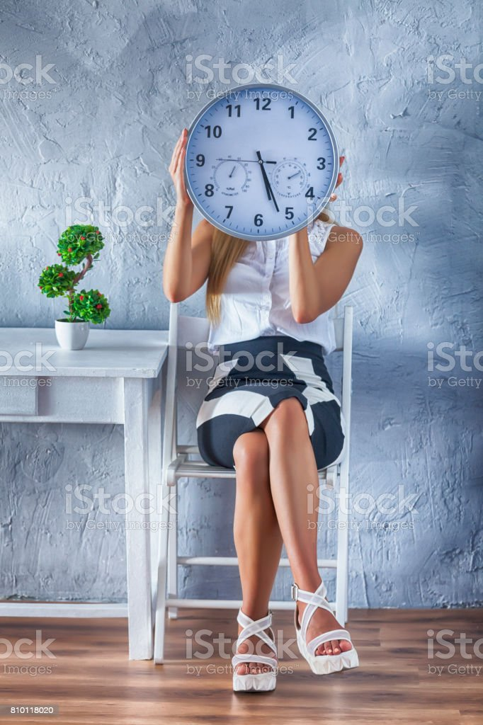 Woman and clock stock photo