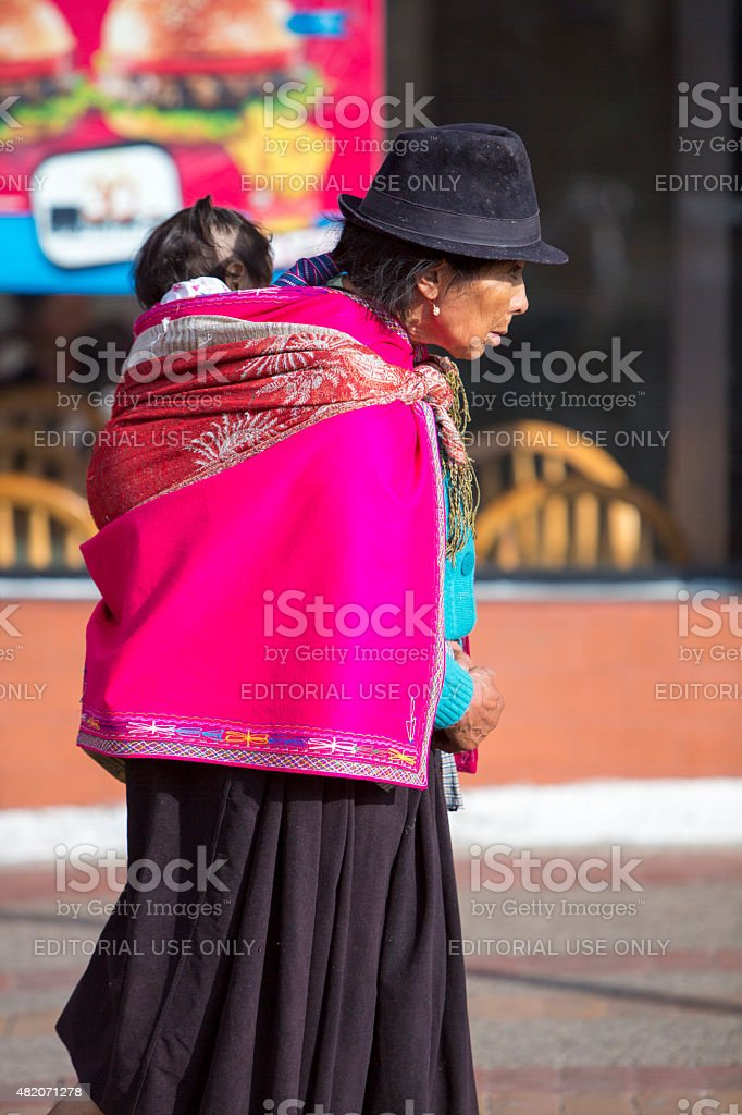 Woman and daughter at the Otavalo market, Ecuador stock photo