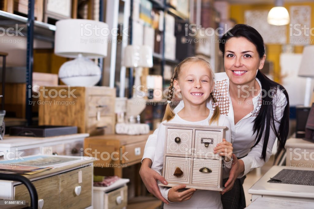 Woman and daughter choosing new curbstone stock photo