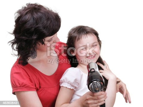 639833996istockphoto woman and daughter Little girl dries hair isolated 463608431