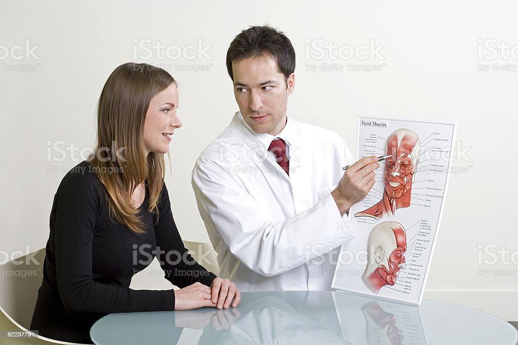 Woman and doctor planning cosmetic surgery at consultation royalty-free stock photo