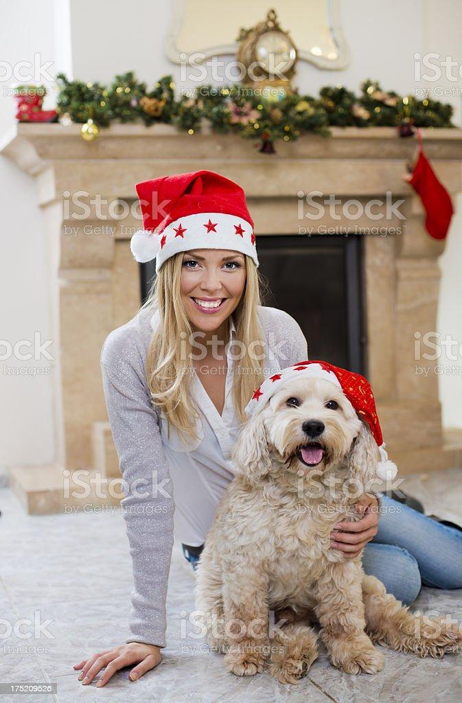 Woman and dog at Christmas royalty-free stock photo