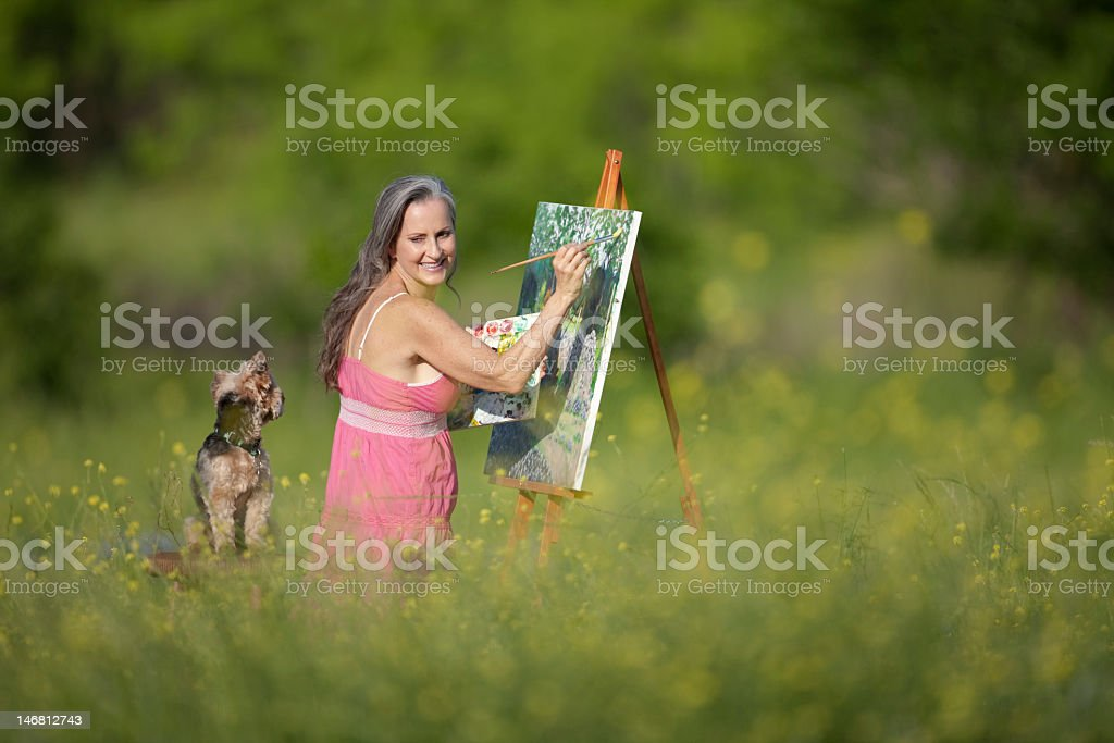 Woman and Dog In Field of Wildflowers royalty-free stock photo