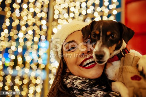 istock Woman and dog - New Year's Eve 1187620161