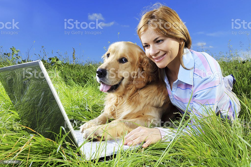 Woman and dog resting on meadow. royalty-free stock photo