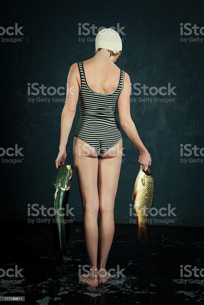 Frau und Fisch – Foto