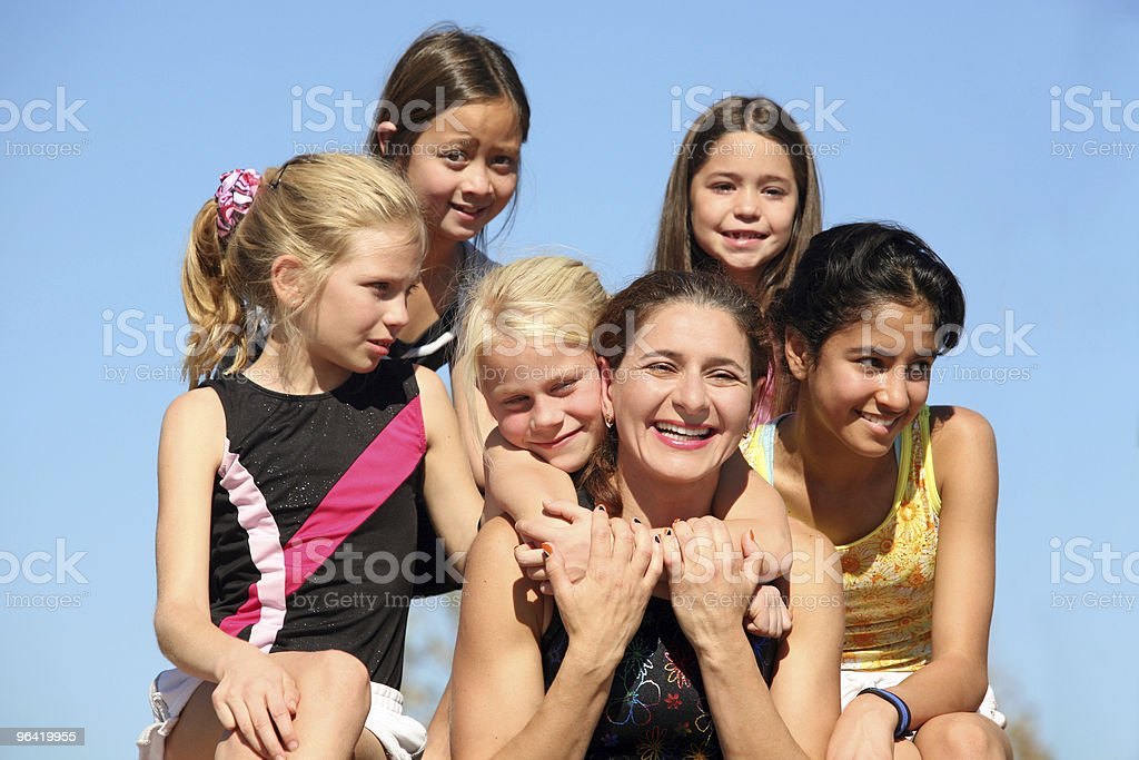Woman and five girls royalty-free stock photo
