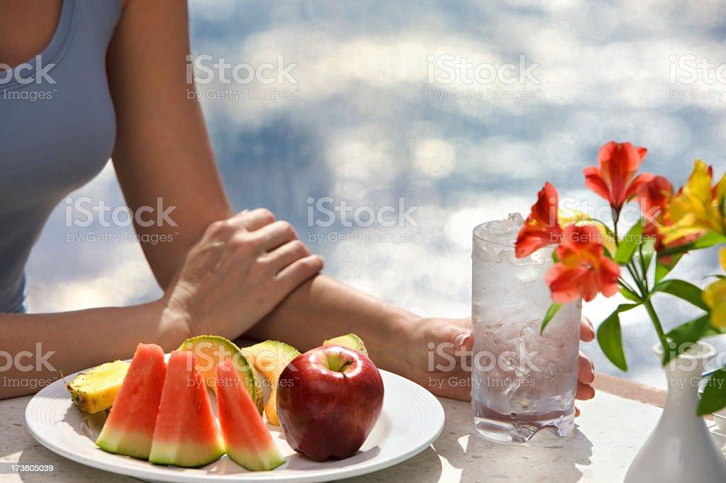 woman and fruit plate royalty-free stock photo