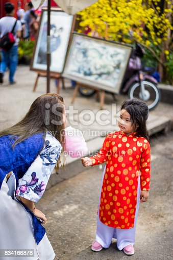 865399512istockphoto Woman and girl wear happy new year's traditional 834166878