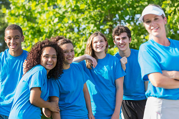 Woman and group of teens stock photo