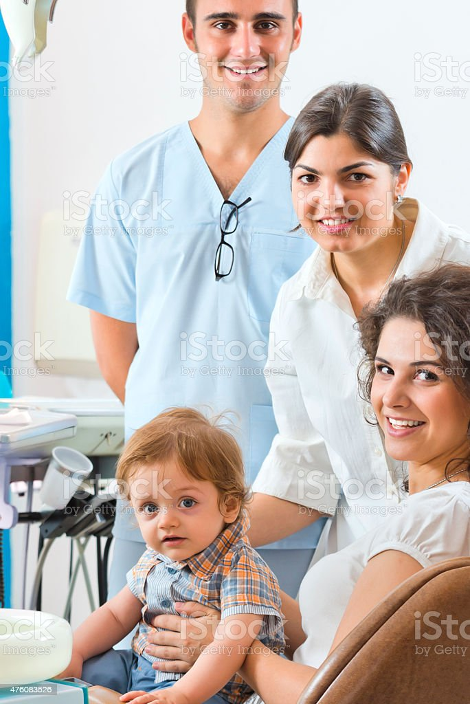 Woman and her baby in the dental clinic stock photo