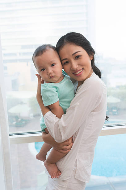 Woman and her baby stock photo
