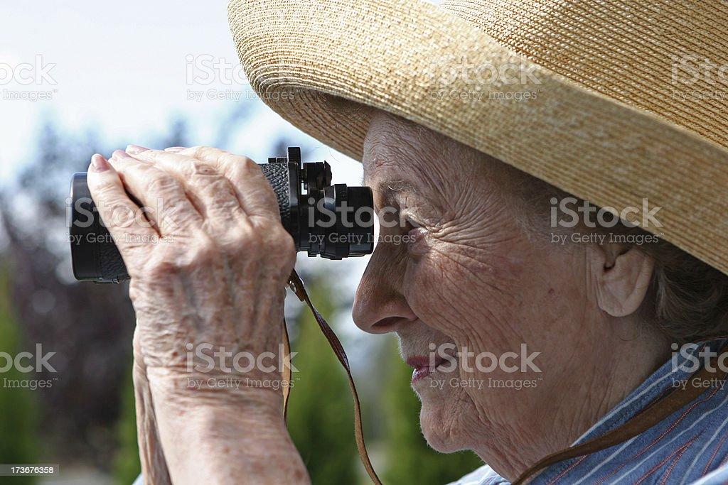 Woman and her binoculars stock photo