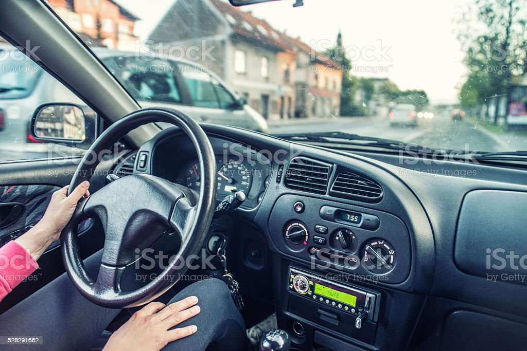 Woman And Her Car, Unsafe Driving Stock Photo
