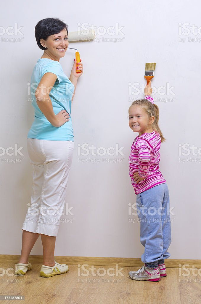 Woman and her daughter doing home repair royalty-free stock photo