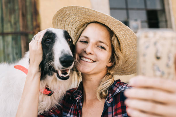 Woman and her dog taking selfie stock photo