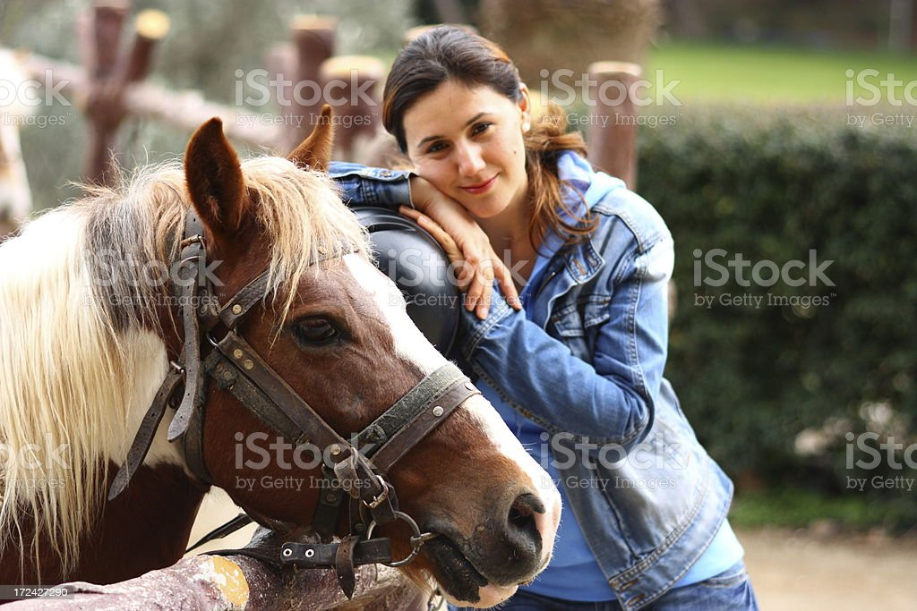 Woman and her horse royalty-free stock photo
