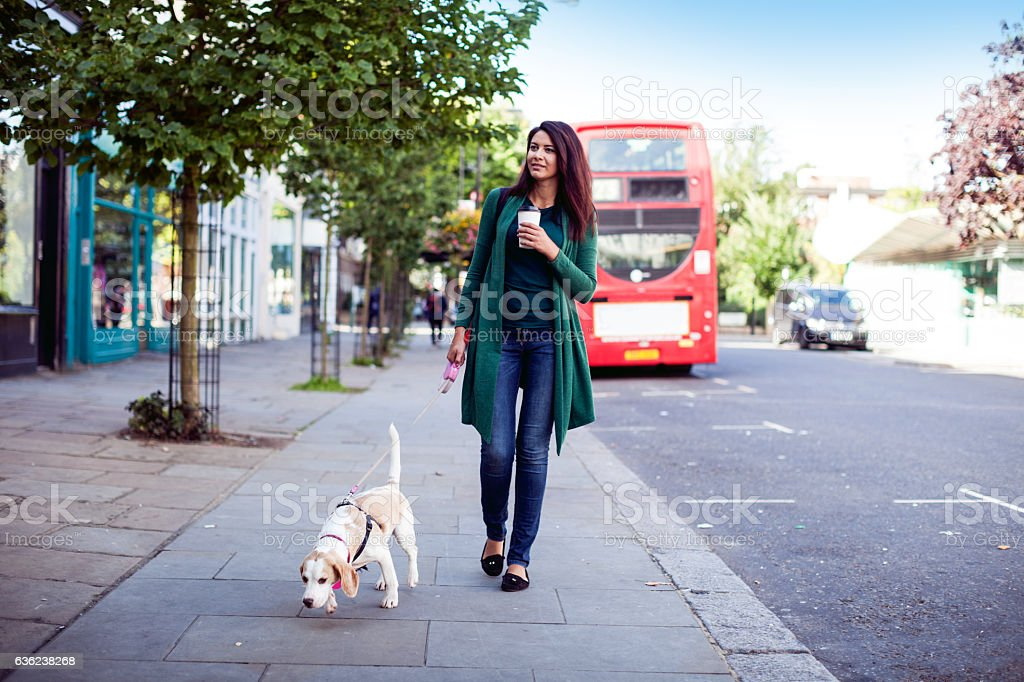 Woman and her own dog in early Sunday morning stock photo