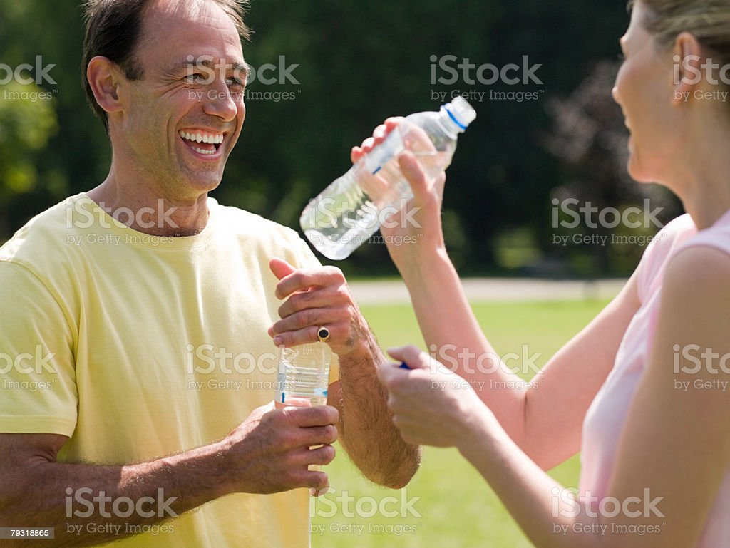A woman and her personal trainer resting 免版稅 stock photo