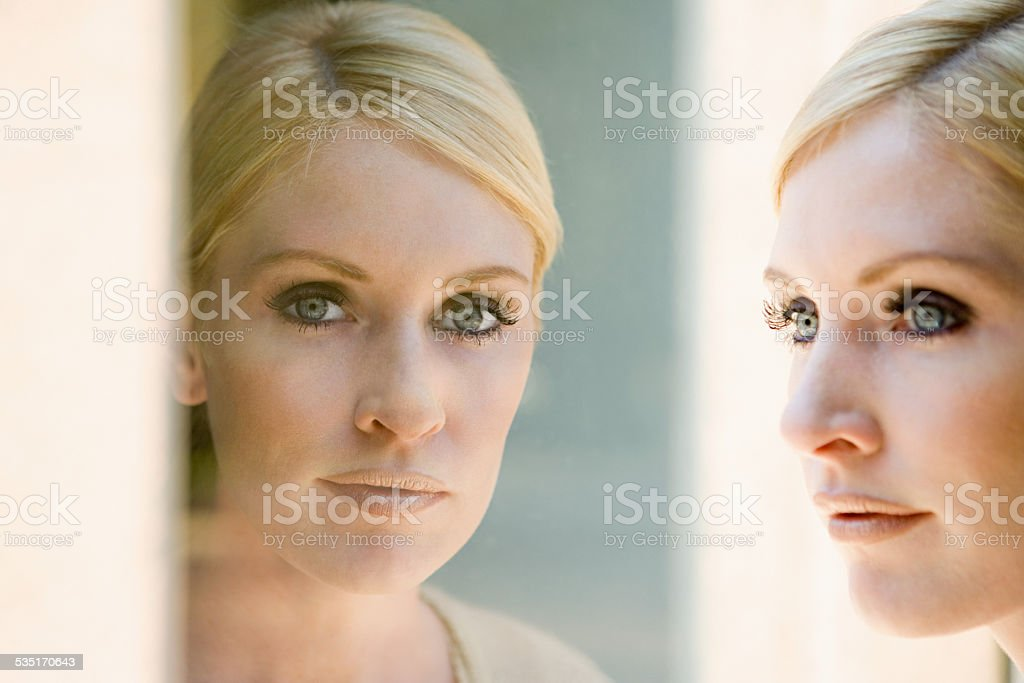Woman and her reflection stock photo