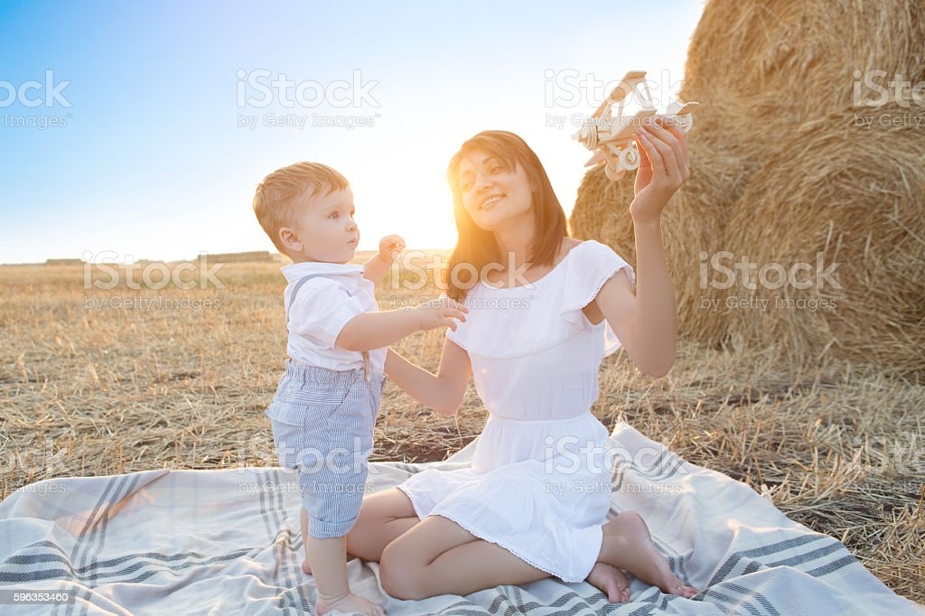 Woman and her son playing with toy airplane . royalty-free stock photo