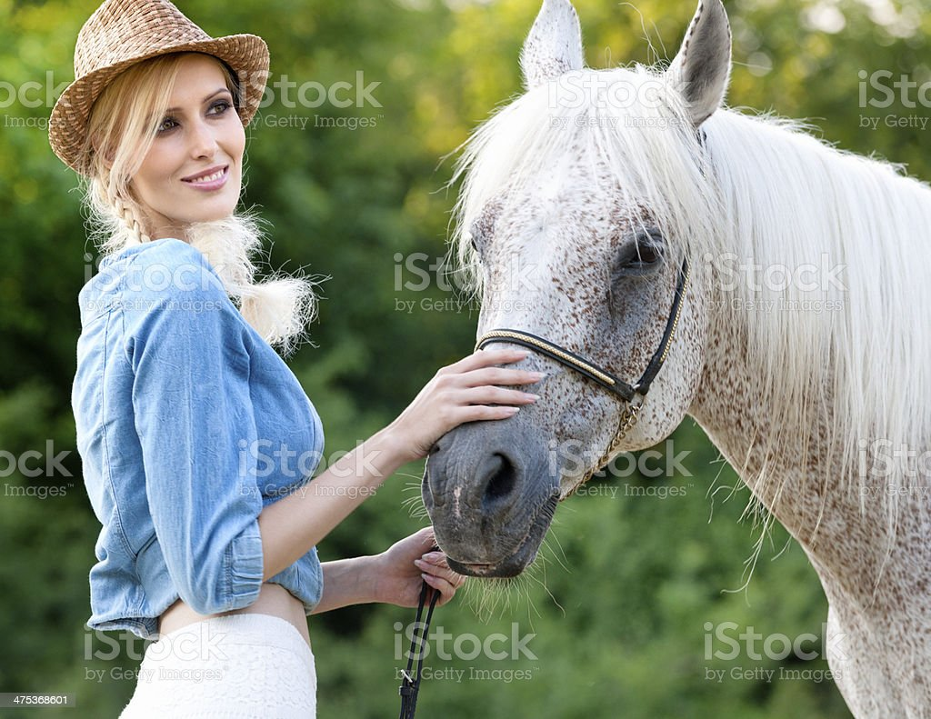 woman and horse in meadow royalty-free stock photo