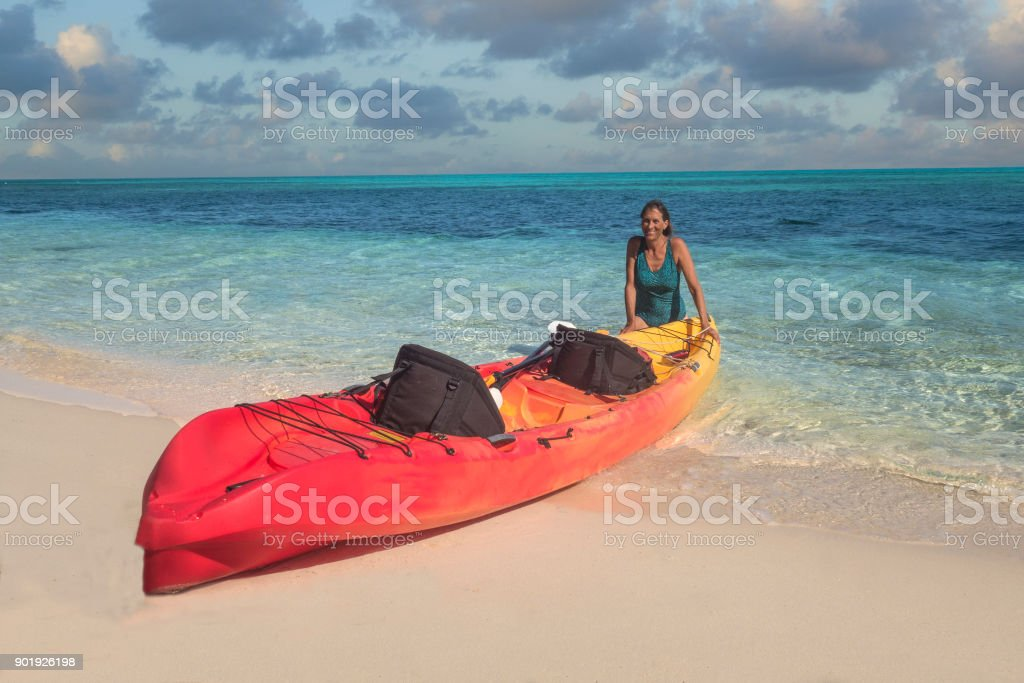 Woman and kayak stock photo