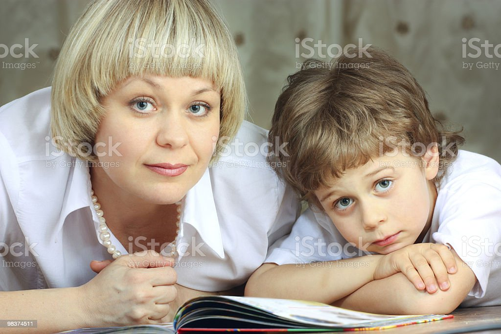 woman and little boy reading book royalty-free stock photo