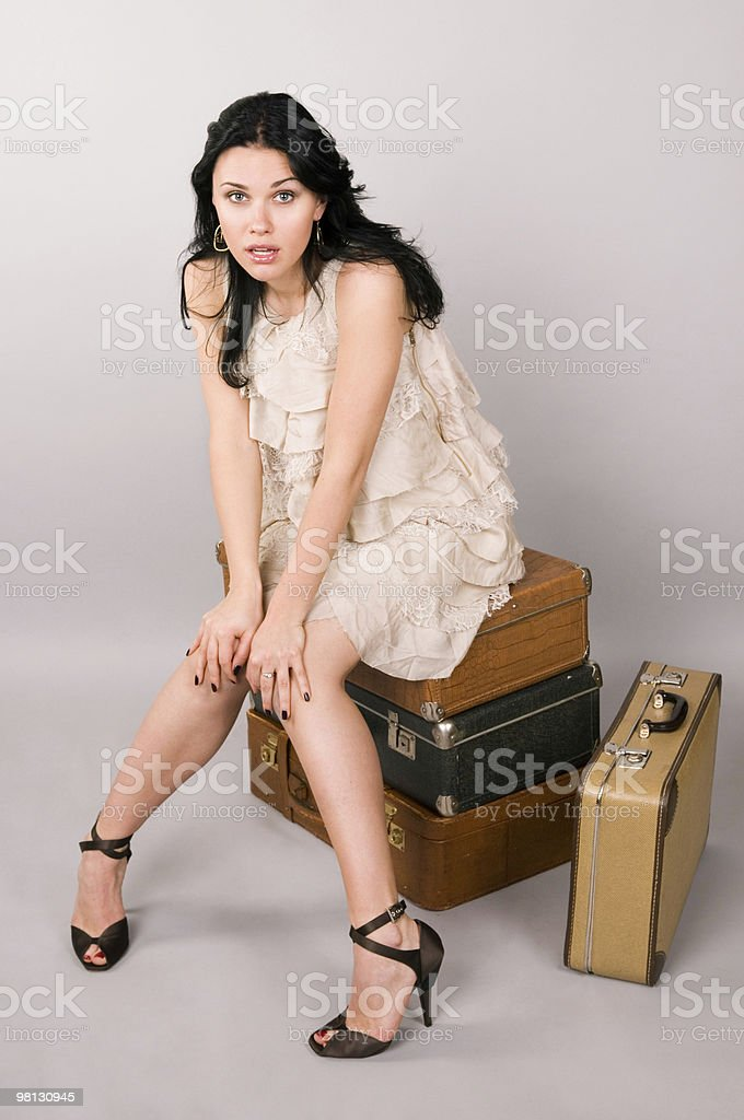 Woman and luggage. royalty-free stock photo