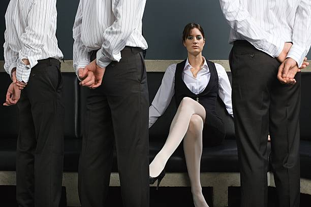 woman and male employees - man dominating woman stock photos and pictures