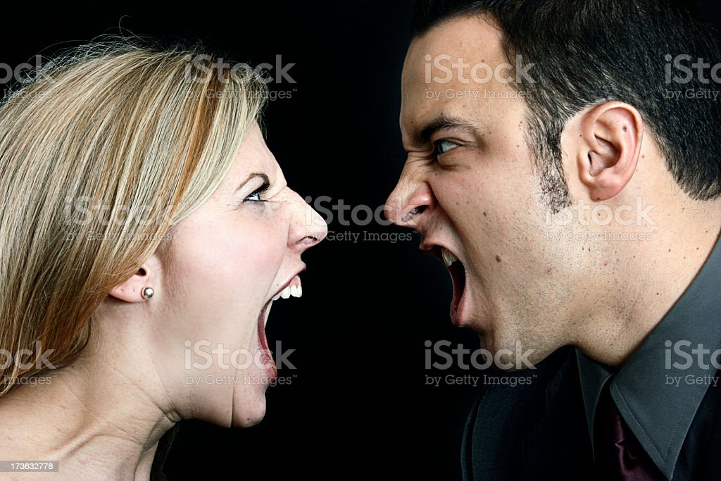 Woman and man close-up with mouths open screaming royalty-free stock photo