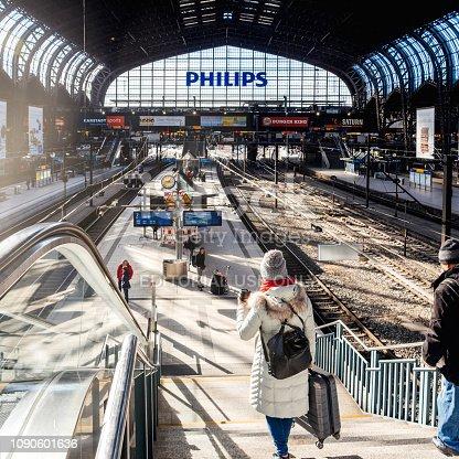 Hamburg: Woman and man descending the stairs at Hamburg Hauptbahnhof