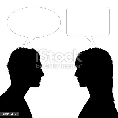 silhouette of profiles of young man and woman face to face with vacant text bubbles