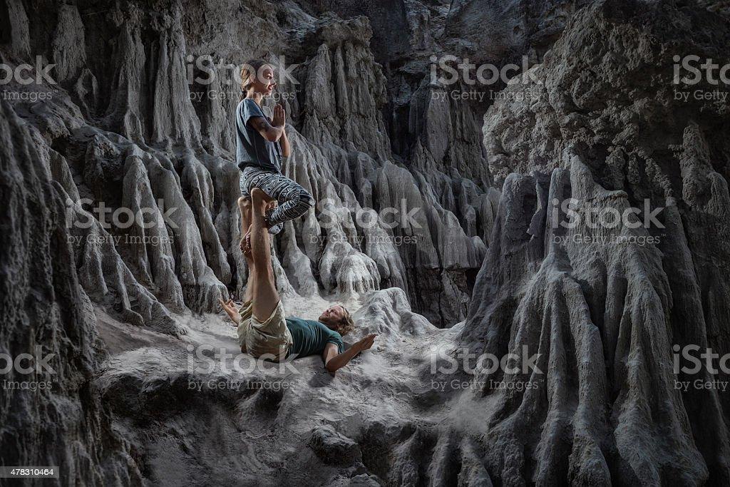 Woman and man doing acro yoga stock photo