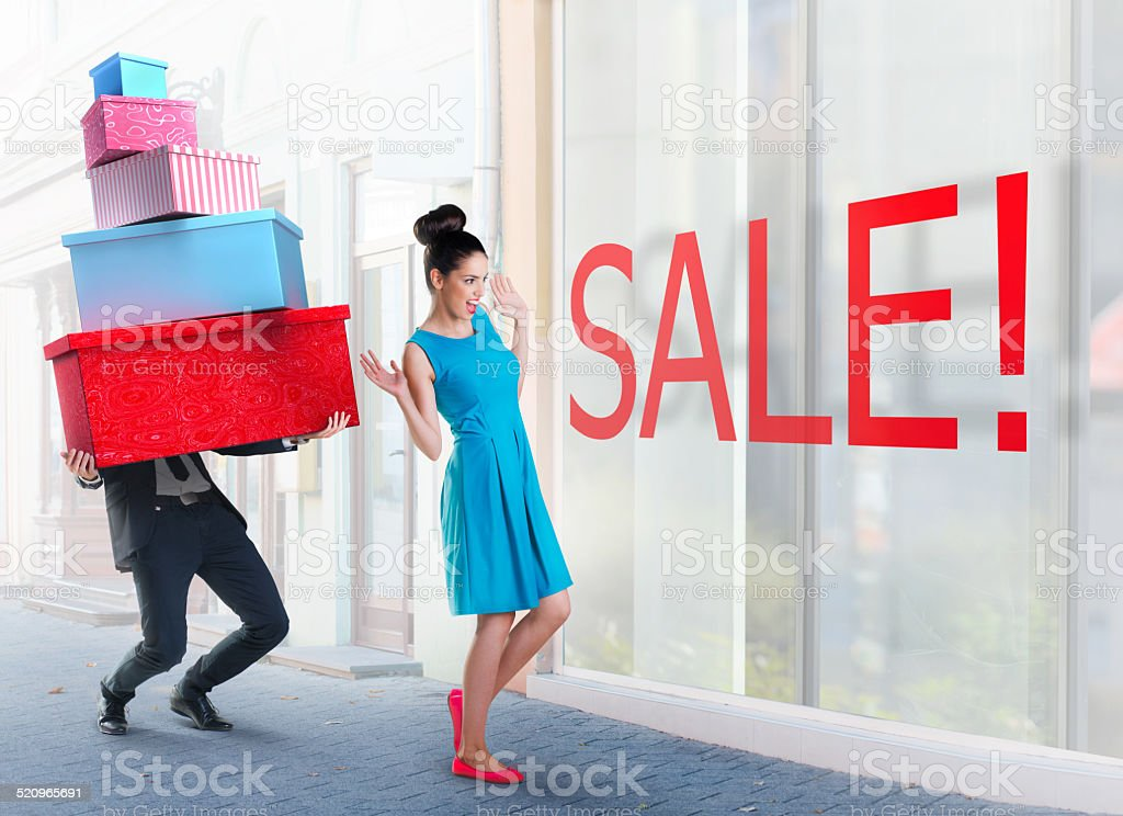 Woman and man going shopping downtown stock photo