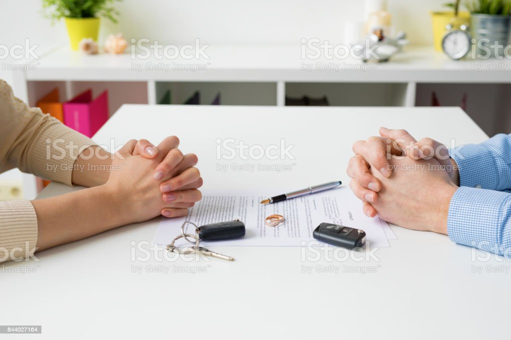 Woman and man going through marriage contract stock photo