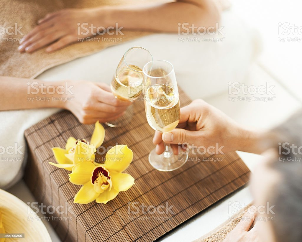 woman and man hands with champagne glasses stock photo
