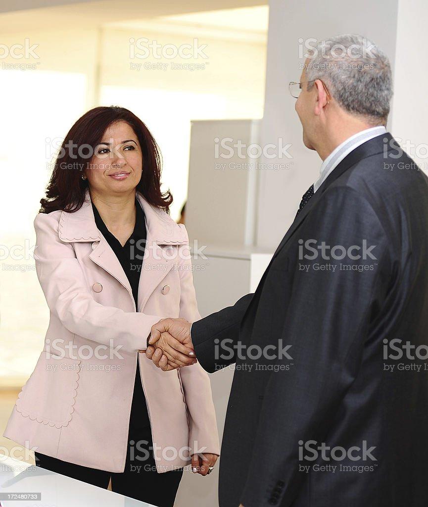 Woman and man handshake royalty-free stock photo