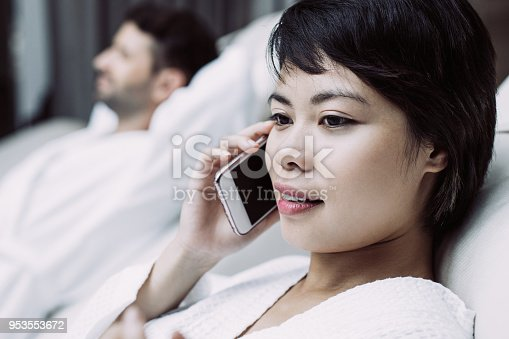 610769340istockphoto Woman and Man Having Rest on Loungers in Spa Salon 953553672