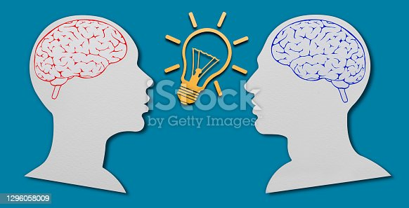 Paper Cut, Face To Face Woman And Man Heads. Gender equality idea concept. Idea light bulb symbol between head shapes with clipping Path.