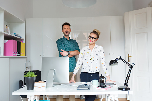 Woman And Man In An Office Stock Photo - Download Image Now