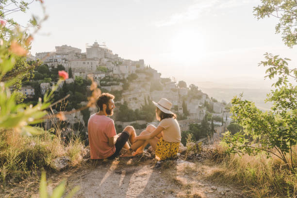 Woman and man looking at scenic view  of Gordes village in Provence Young Caucasian woman and man looking at scenic view  of Gordes village in Provence provence alpes cote d'azur stock pictures, royalty-free photos & images