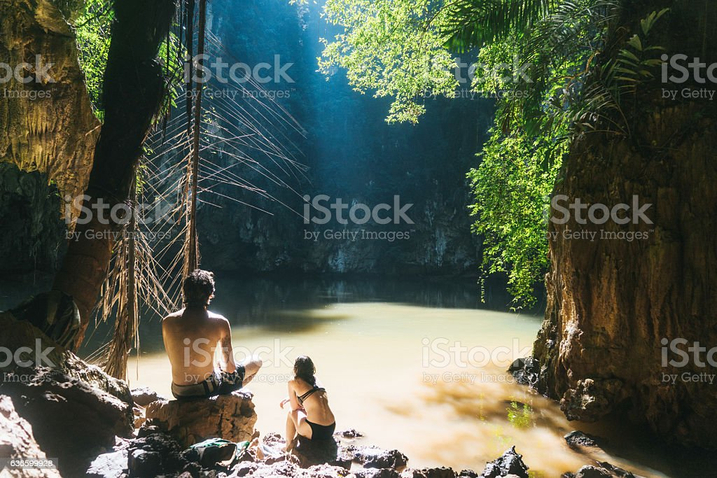Woman and man near lagoon in the jungles stock photo