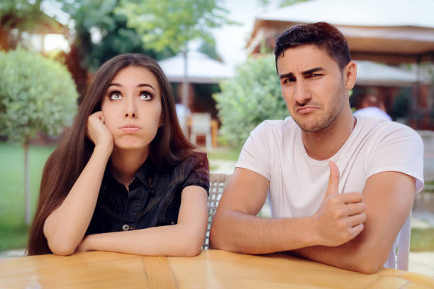 Woman and Man on a Boring Bad Date stock photo