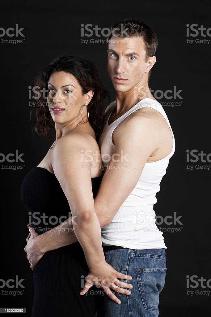 Woman and man on dark background royalty-free stock photo