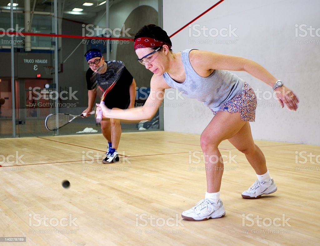 Woman and man playing squash royalty-free stock photo