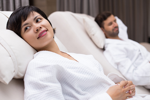 610769340 istock photo Woman and Man Relaxing after Spa Treatment 610769484