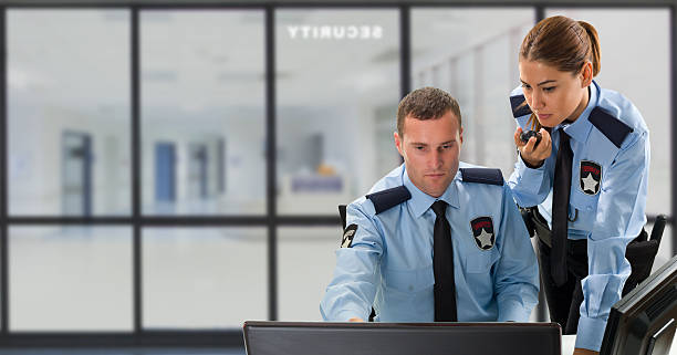 Woman and Man Security Guard Security guards are working in security room. security staff stock pictures, royalty-free photos & images