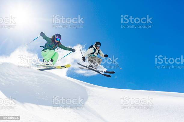 Woman and man skiing and jumping picture id660685390?b=1&k=6&m=660685390&s=612x612&h=z0 lab3wgijsoro44s 8xjfd7sh2ps 8 qgiucogd9y=