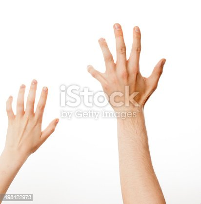 istock woman and man up hand reaching for something, isolated 498422973